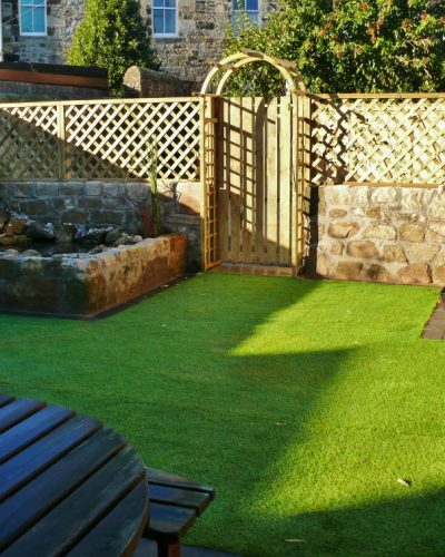 GATE, SANDSTONE WALLS & POND, ARTIFICIAL GRASS IN BURNTISLAND