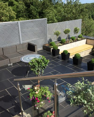 COMPOSITE DECKING & DARK LIMESTONE IN LESLIE
