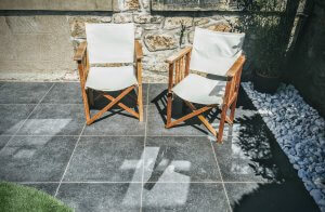 Porcelain paving and deck chairs