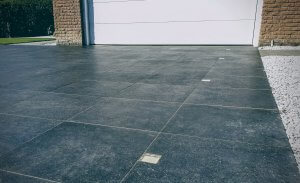 Porcelain driveway in front of garage
