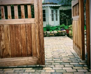wooden gate leading on to driveway