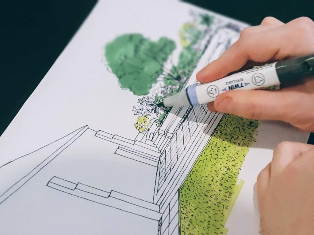 Man drawing a landscaping plan