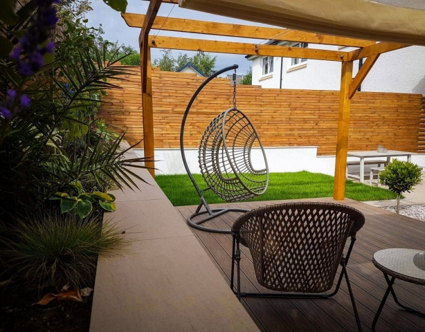 Wooden pergola with roof, seating area