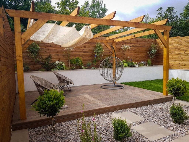 Wooden pergola with rood and seating area, front view