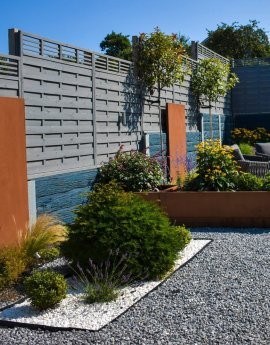 A CONTEMPORARY GARDEN WITH CORTEN STEEL FEATURES AND PORCELAIN PAVING
