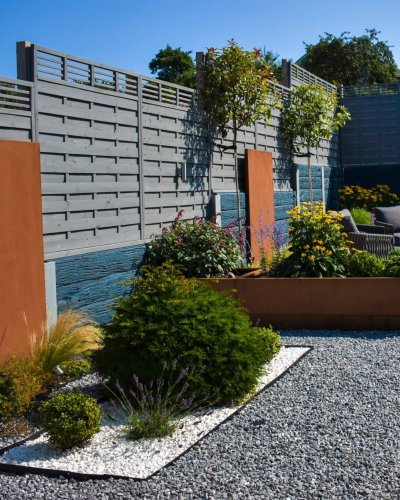 CONTEMPORARY GARDEN WITH CORTEN STEEL FEATURES AND PORCELAIN PAVING